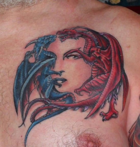 The two dragons fighting in this tattoo design are positioned perfectly to form the features of a womans face