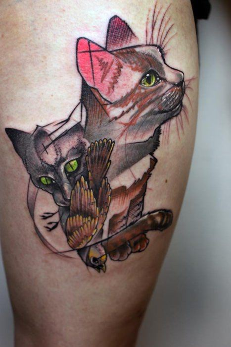 This abstract illustration tattoo shows two cats and a bird, their favorite prey