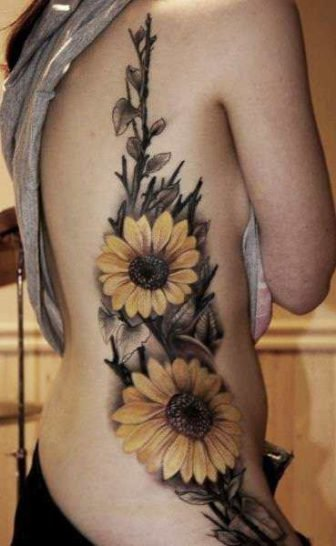 This stylish sunflower tattoo uses subdued colors but still apears fun and friendly