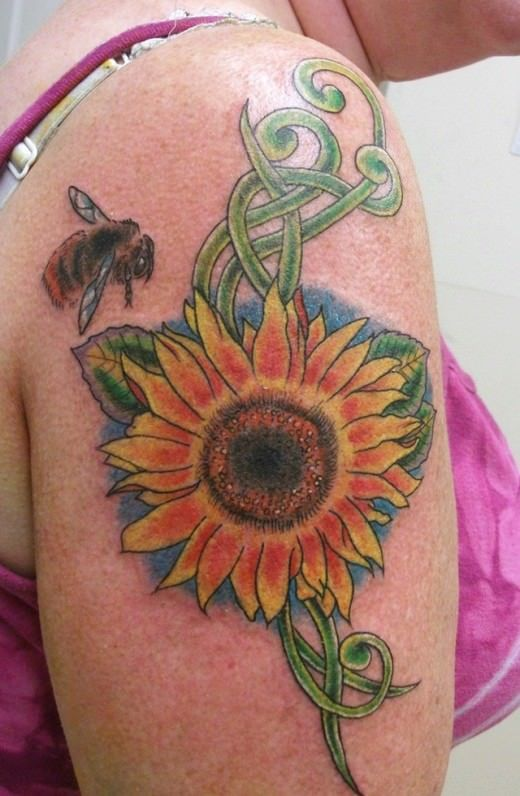 This sunflower tattoo design has a bee hovering nearby. Both are symbols of life and fertility
