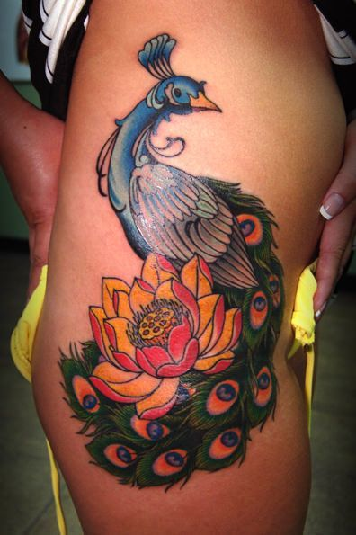 A boldly outlined style gives this colorful peacock tattoo a crisp, neat appeal