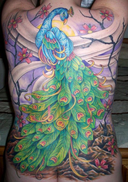 Beauty and new beginnings are symbolized in this cherry blossom and peacock tattoo