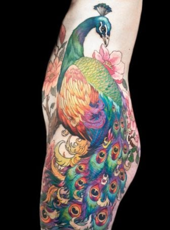 This amazing peacock tattoo across the hip and leg can be hidden under clothing and revealed only to an intimate loved one
