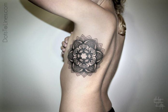 Chaim Machlev creates a feminine mandala flower tattoo out of spiritual saced geometry