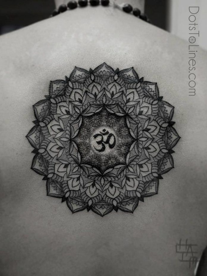 Chaim Machlev uses the ohm symbol for spirituality in this dotwork mandala flower tattoo