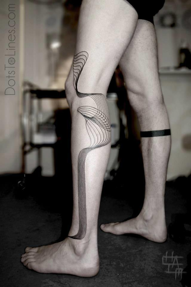 Geometric patterns become an unusual math tattoos in this leg tattoo by Chaim Machlev