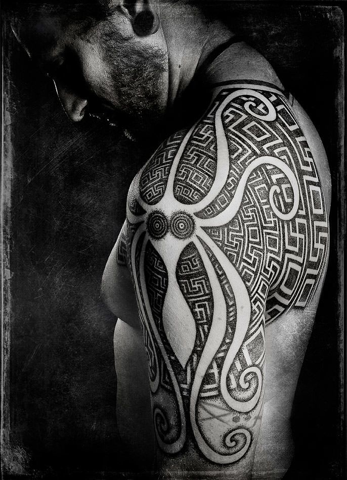 Peter Madsen creates an abstract octopus tattoo with sacred geometry designs