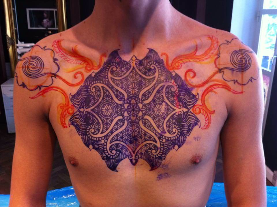 Peter Walrus Madsen prefers to create his spiritual, tribal tattoos direcly on the client to honor the shape of the body