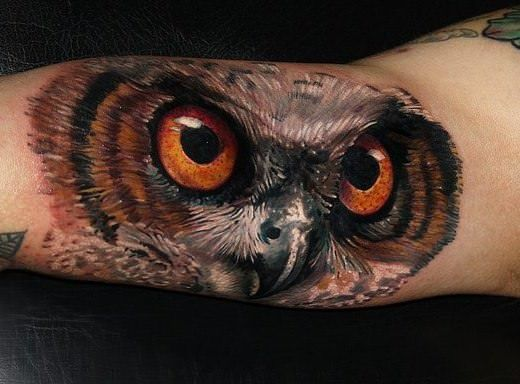 Tattoo artist Carlox Angarita has created a stunning photo realistic tattoo of an owl on the inside of the forearm