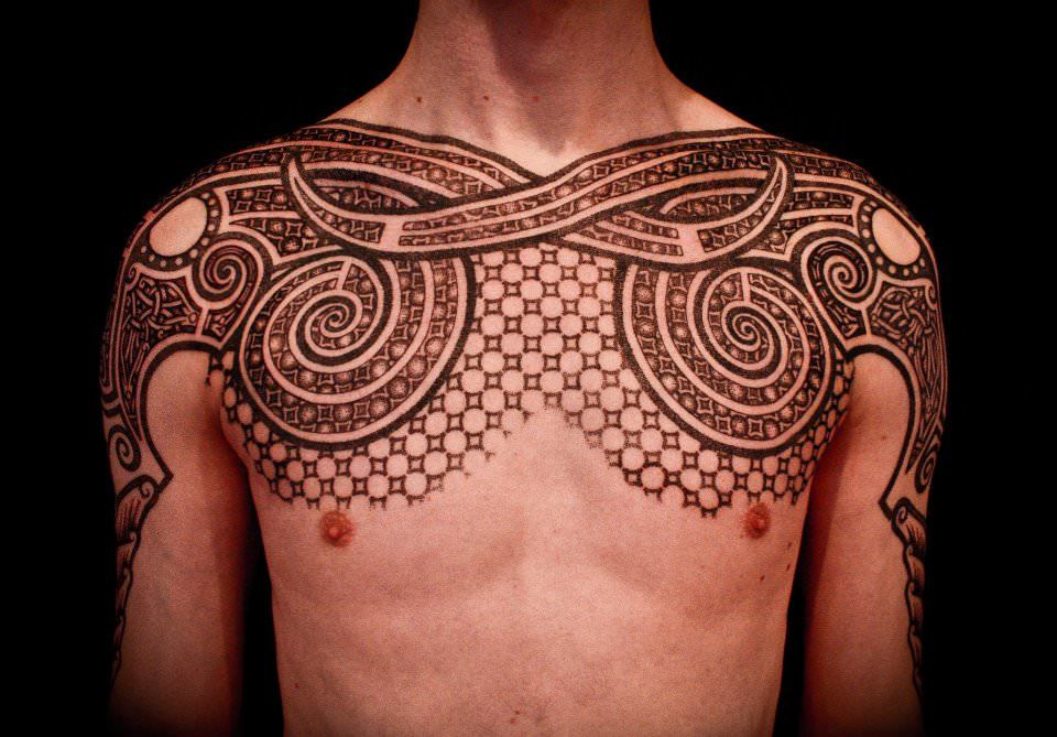 Using brown tattoo ink and a dotwork technique, Peter Madsen has created an ornamental chest tattoo design