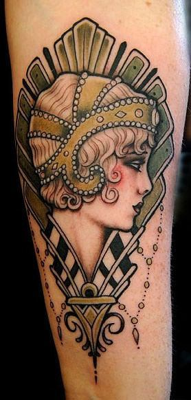 A beautiful girl with pearls in her hair is the subject of this Art Deco tattoo