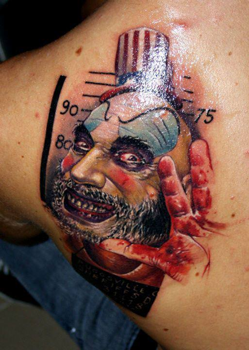 A nasty clown is the subject of this photo realistic surrealist tattoo by Asutrian tattoo studio Nadelwerk