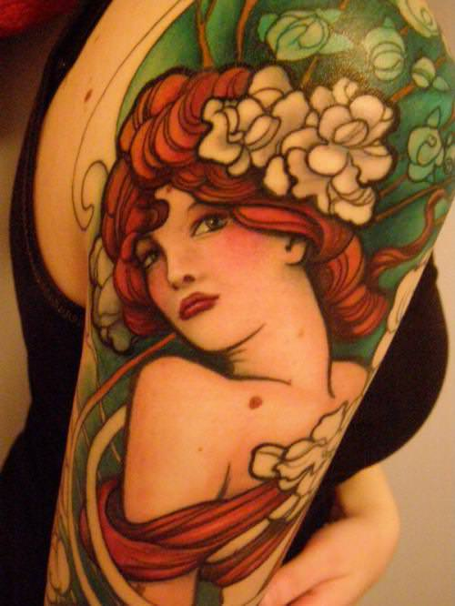A stunning Jeff Gogue Art Deco tattoo of a pin up girl with flowers in her hair