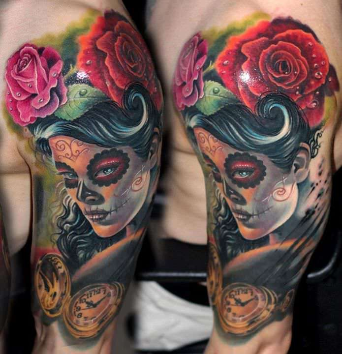 A woman wears sugar skull make-up in this photo realistic portrait tattoo by Nadelwerk