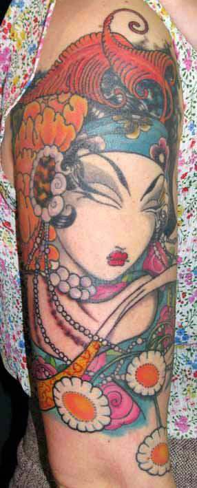 East meets west in this geisha tattoo by Venus Flytrap that combines art styles and fashions to express femininity
