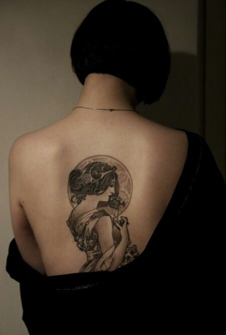 Even when tattooed in black and grey ink, an Art Deco tattoo design is beautiful and decorative