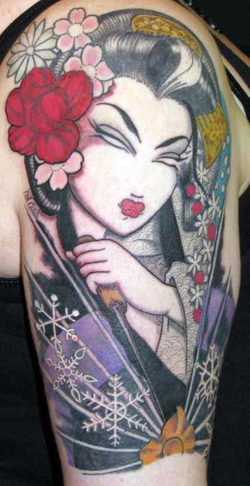 Flowers and snowflakes add to the meaning of this geisha tattoo by Venus Flytrap