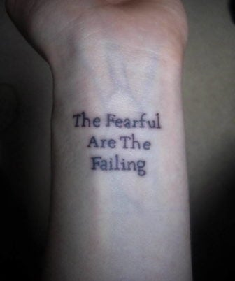 Simple typography spells out a powerful motivation for life in this quote tattoo
