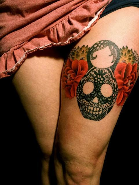 Tattoo artist dodie makes a skull out of a nesting doll in this lace and paisley tattoo for girls