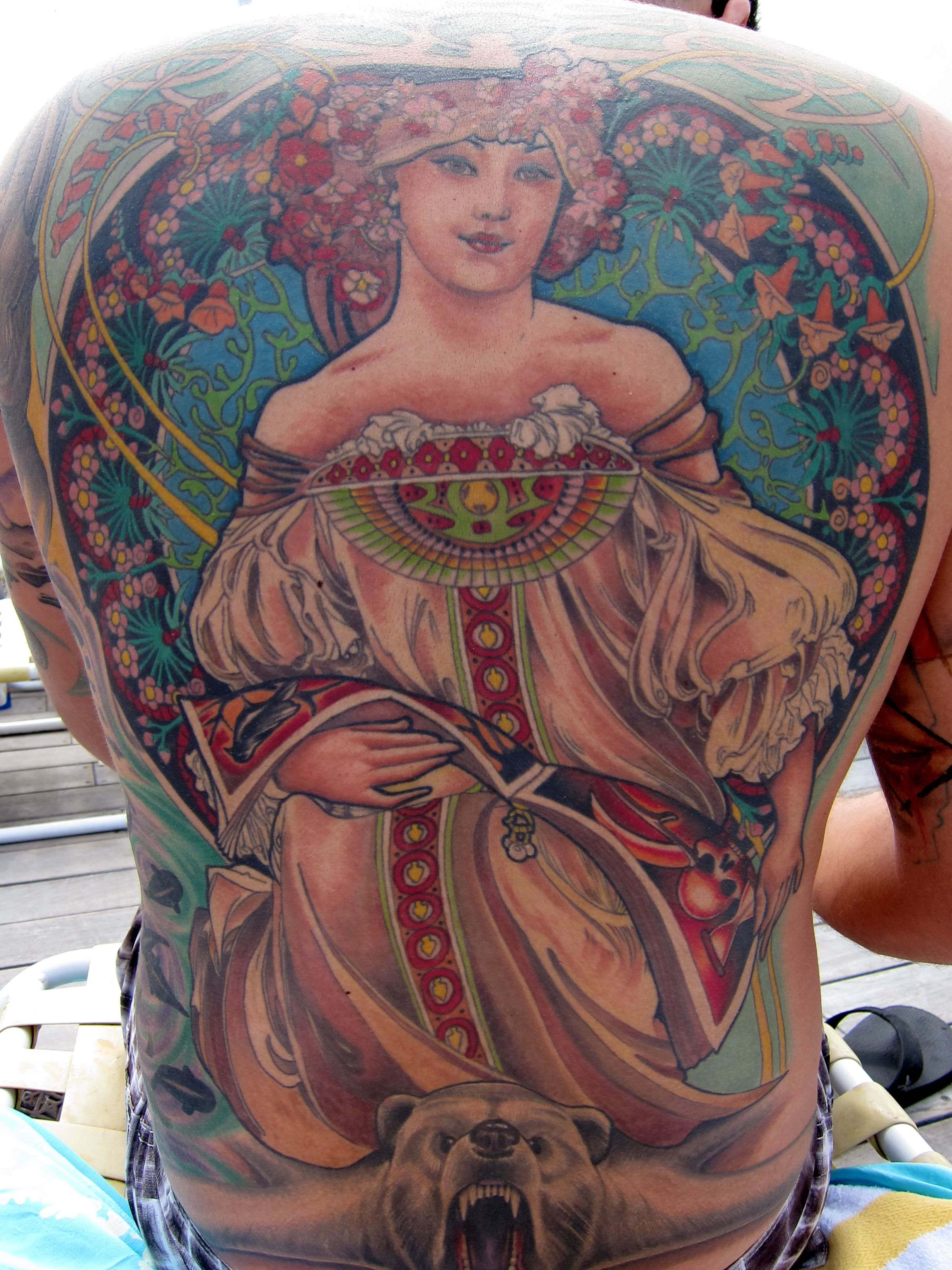 The bright colors and intricate details of Art Deco tattoos are appealing up close and from a distance
