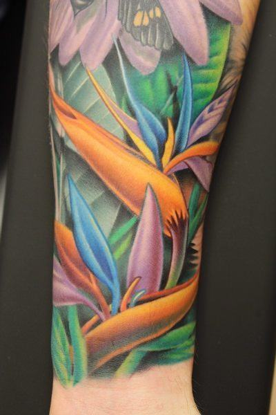 Whether alone or in a busy scene, the bird of paradise flower makes an eye catching tattoo design