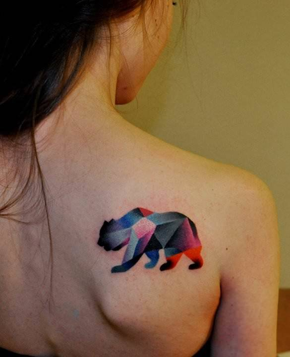A cubist bear honors 20th century art in this artistic animal tattoo by Marcin Surowiec