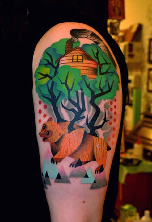 Marcin Surowiec uses cubist shapes and and abstract forms to create this colorful tattoo of a bear in the woods