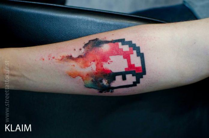 French tattoo arist KLAIM gives a mushroom from the Mario Bros video game an artistic edge