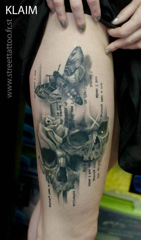 KLAIM combines typography and realistic pencil drawings in this aristic tattoo of a moth and human skulls