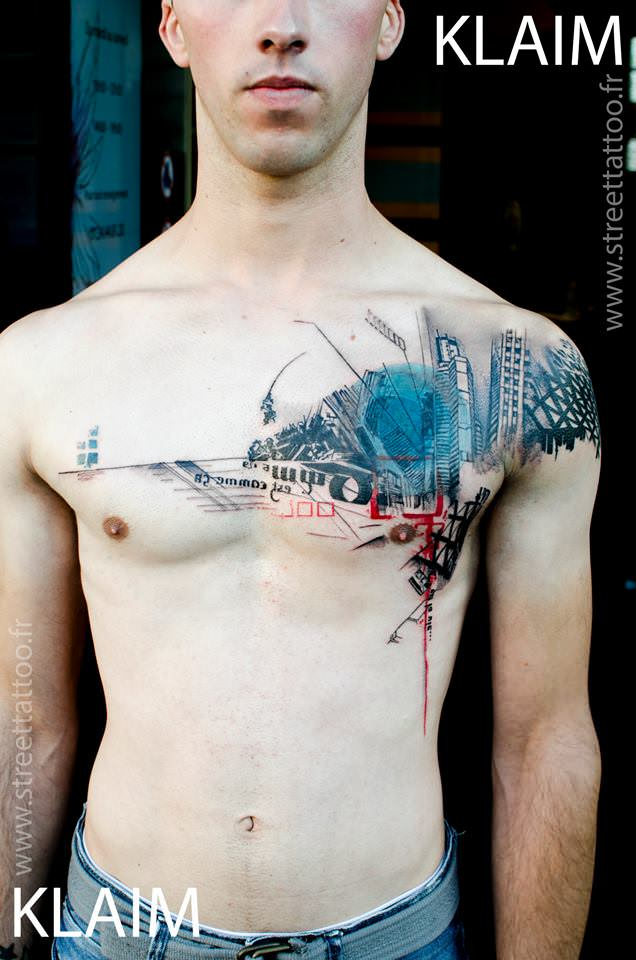 Tattoo artist KLAIM creates a cityscape street tattoo that is designed to work with the shape of his clients body