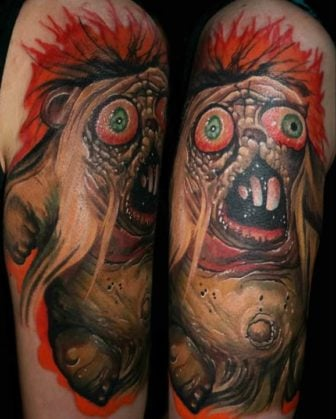 A horror bear gets a gory and colorful life on skin in this surrealist tattoo by Guil Zekri