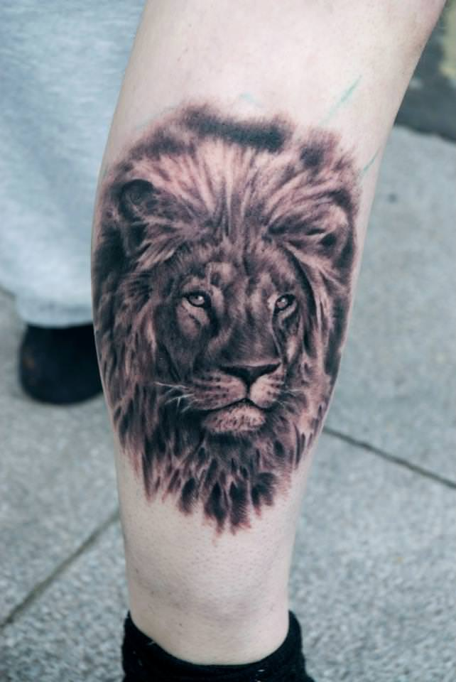 A lion comes alive in this photo realistic black and white portrait tattoo by Csiga