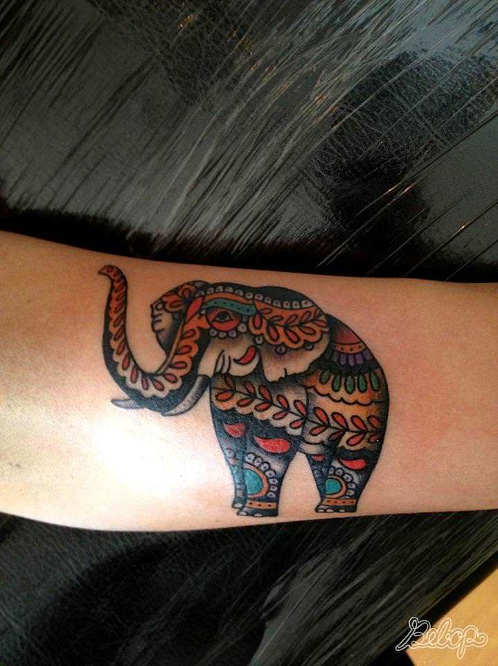An elephant is decorated with paisley patterns in this for Meaning of elephant tattoo