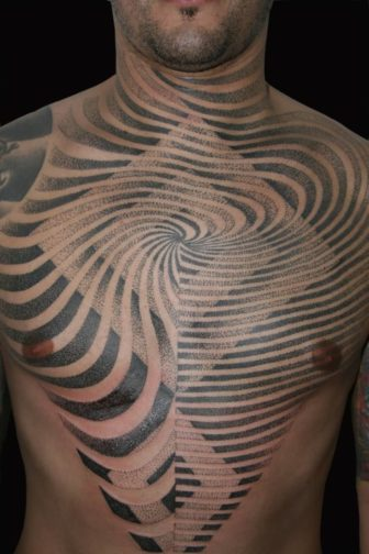 Flowing lines and sharp edges converge in this sacred geometry tattoo in a dot work style by Nazareno Tubaro