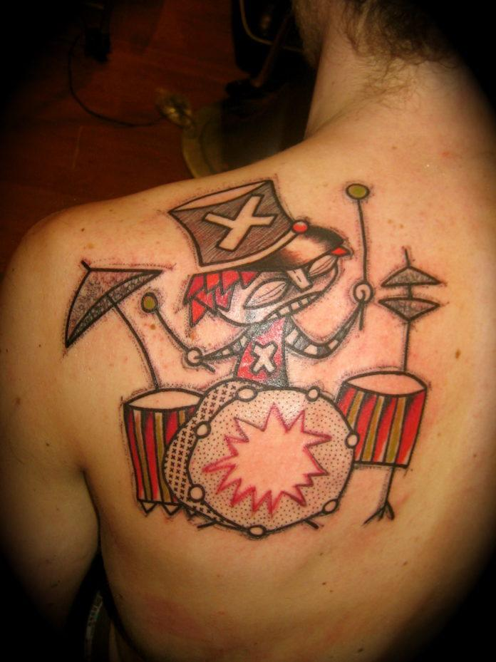 French tattoo artist Noon creates a tough looking but fun drummer tattoo in an avante garde style