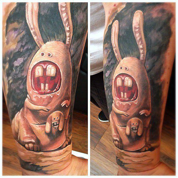 Humorous horror bunnies resemble kangaroos in this unusual surrealist tattoo by Guil Zekri