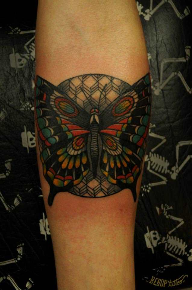Karolina Bebop uses her crisp, bold style to give this butterfly surrounded by geometric shapes life on skin