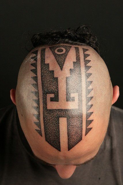 Painful but perfect, this head tattoo by Nazareno Tubaro has tribal, geometry and spiritual elements