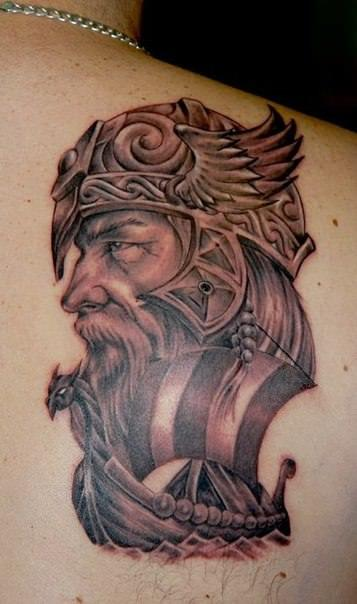 Tattoo artist Csiga creates an ancestry tattoo in this design of a viking with a dragon longboat