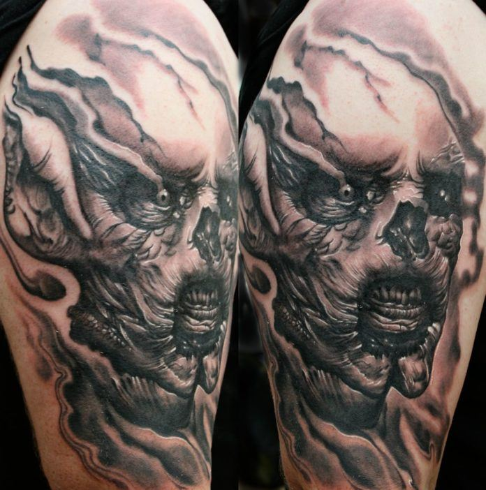 This alienish horror tattoo by Guil Zekri is a good example of this artists skill with black and gray tattoos