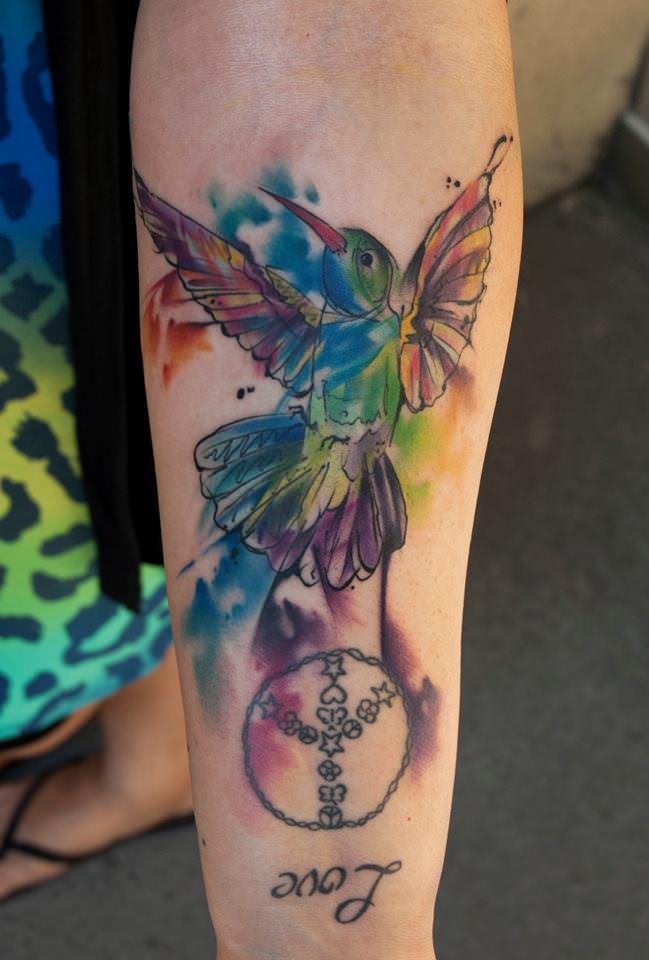 Versatile tattoo artist Csiga creates a watercolor tattoo of a ...