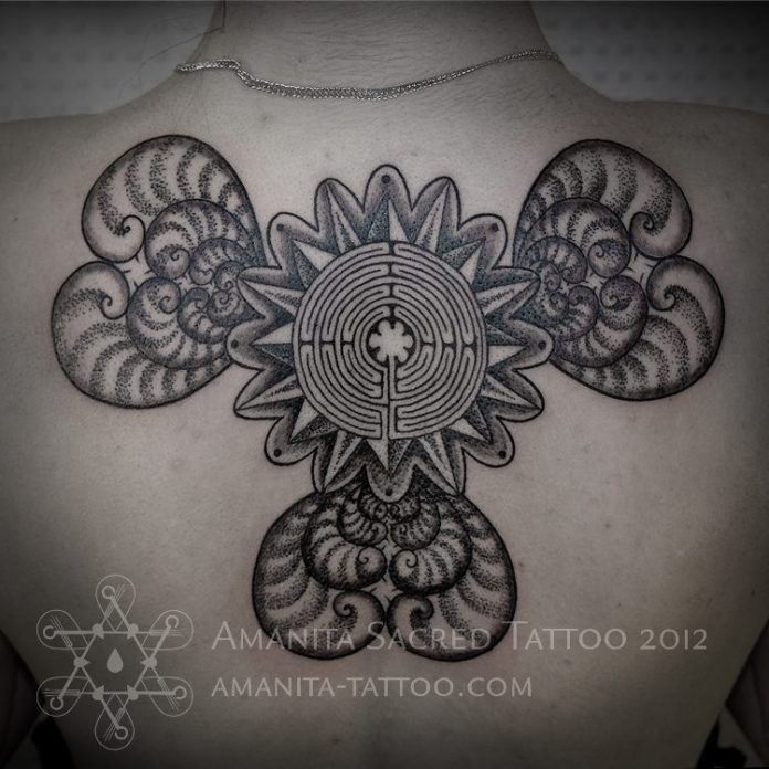 A labyrinth, hearts and floral elements merge to create this sacred geometry back tattoo by Mike Amanita