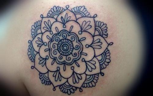 Crisp and clear black ink lines give this spiritual flower of life mandala tattoo design an elegant appeal