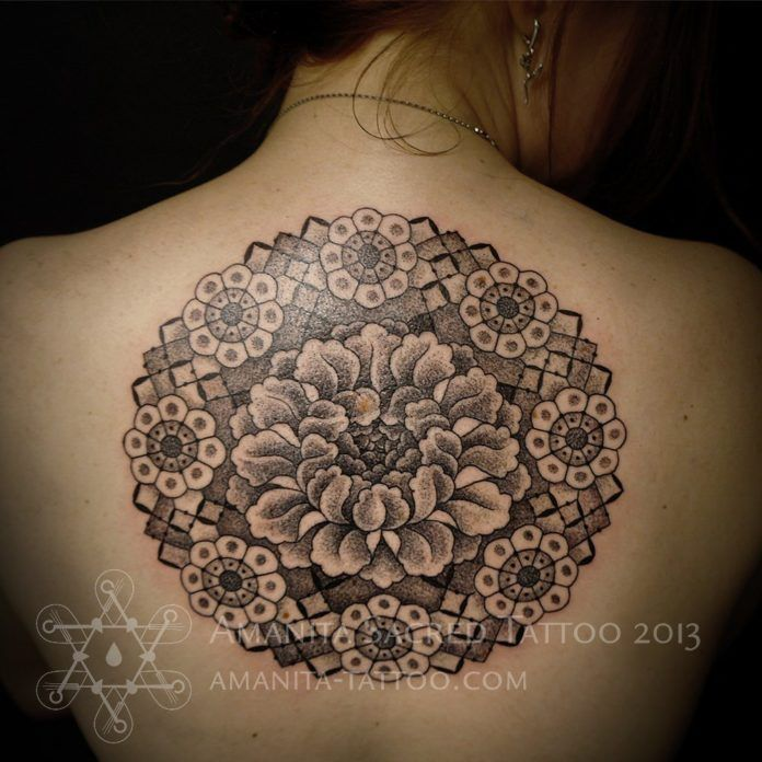 Mike Amanita builds a flower of life mandala around this peony blossom in this spiritual sacred geometry tattoo