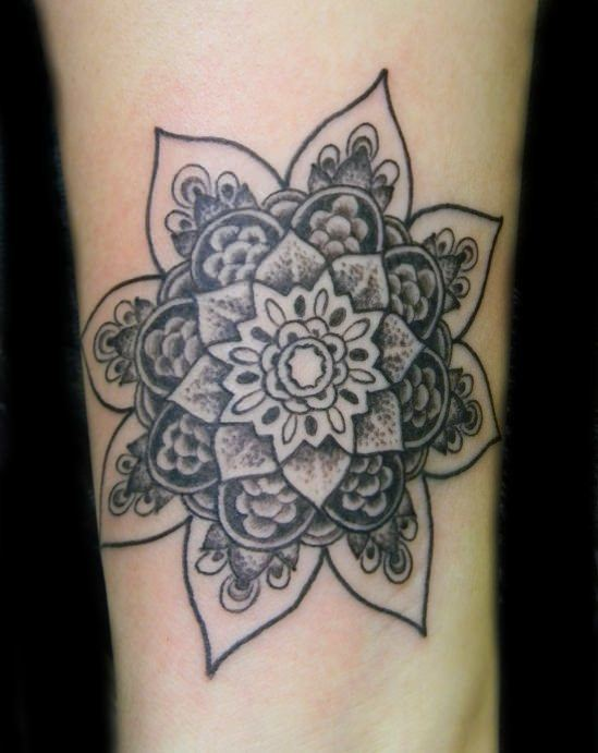 Tattoo artist Galen Luker has used shading and texture to give this beautiful flower of life mandala depth