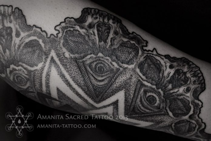 Tattoo artist Mika Amanita uses human skulls and eyes to build up this dotwork mandala tattoo design