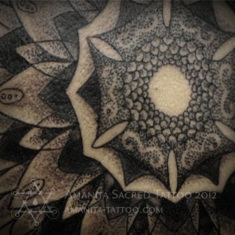 This close up of a mandala tattoo by Mike Amanita reveals how he creates shade and texture with tiny dots