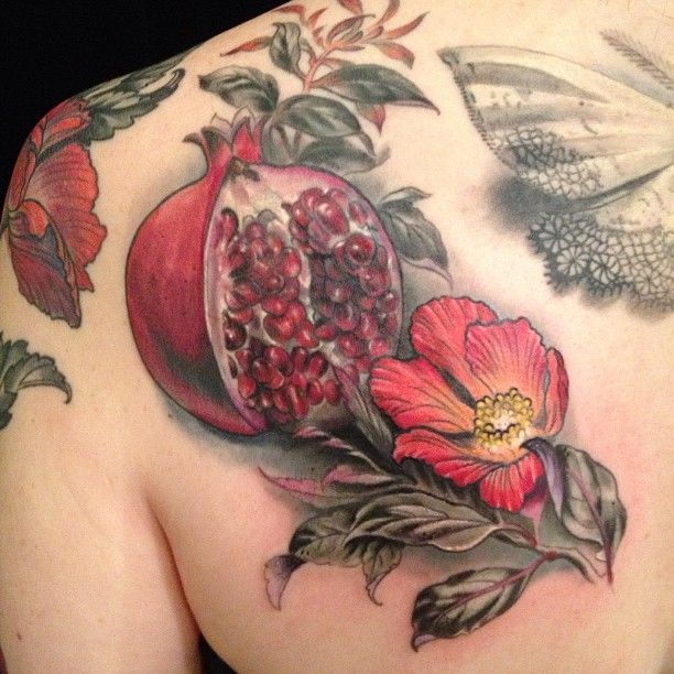 A pomegranate is a powerful symbol of fertility and promise. This beautiful tattoo design comes out of Butterfat Studios.