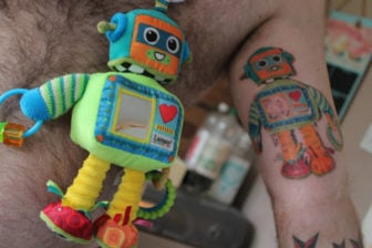 Matthew Bamber gets a tattoo of his sons favorite robot stuffed toy
