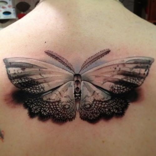 Moths are linked to the moon, and doilies to women of refinement. This lacy paper moth tattoo is an ideal symbol of femininity